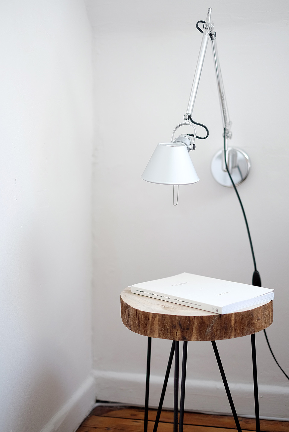 home-portfolio-01.jpg A stool with a book on top